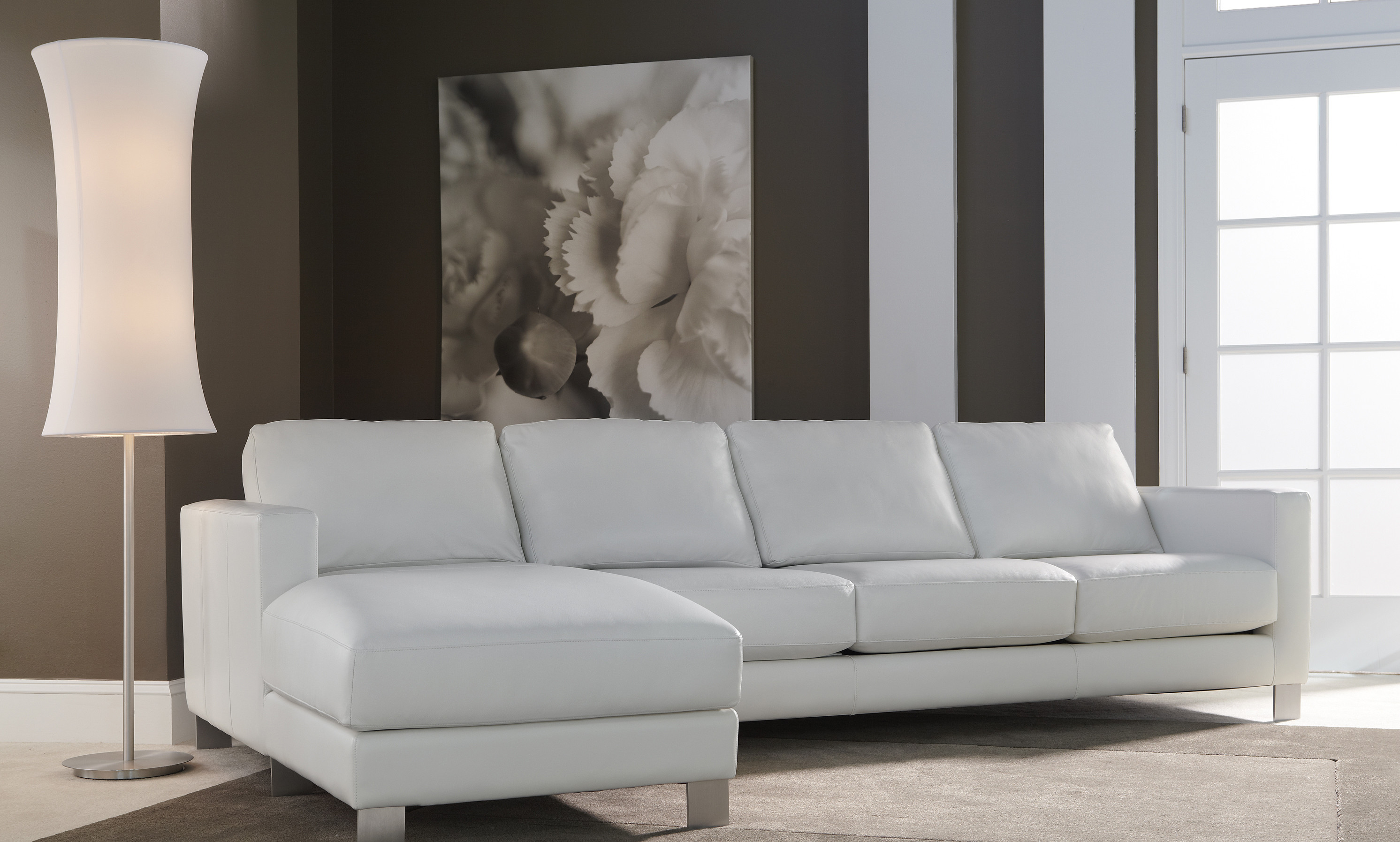 Dove grey leather sofa made by American Leather in modern living room