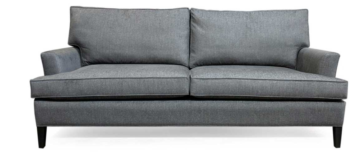Simple grey sofa with 4 cushions and straight clean lines made by Vogel
