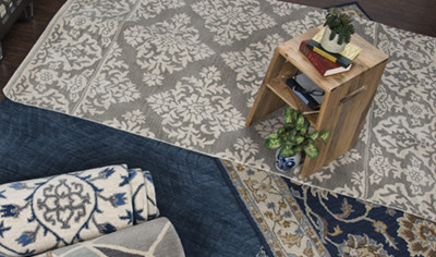 three patterned rugs and one solid blue rug with small wood nightstand placed on top, Rizzy Home