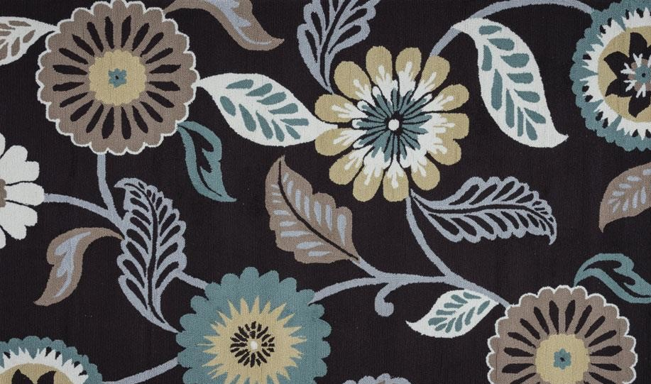floral patterned rug in blue taupe grey and yellow ochre tones with black background, Company C