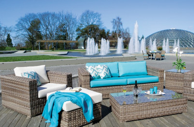 Rattan furniture set with white and blue cushions and fountains trees and a dome in the background, Ratana