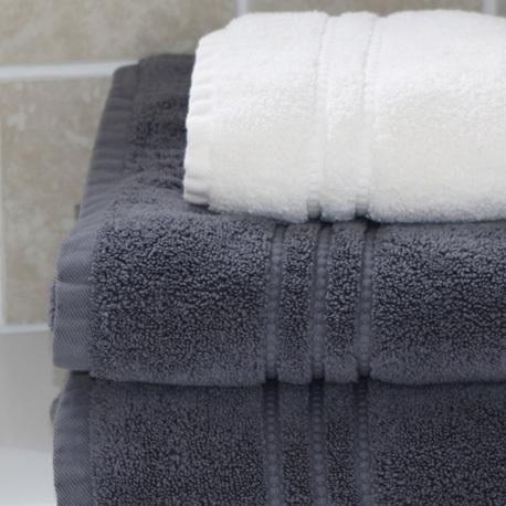 Two dark grey Portofino bath towels and a white hand towel