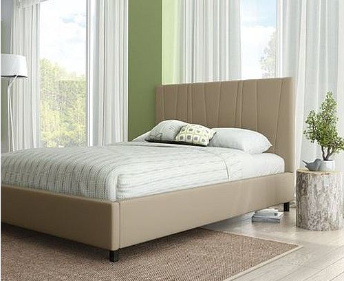 Modern upholstered bed frame in natural linen tones in green room with large windows