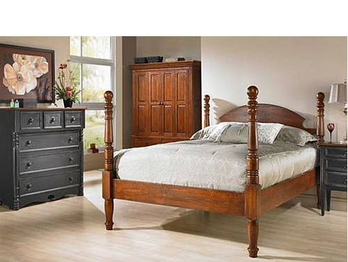 Wood 4 poster bed with matching wardrobe and a black dresser in pale beige room