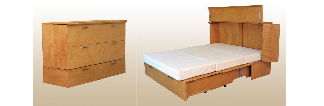 Large light wood cabinet with 3 doors which opens out into a bed