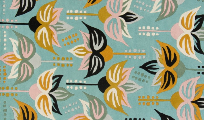 Art deco style floral patterned rug in pale pink white grey black and mustard yellow tones on turquoise ground, Chandra