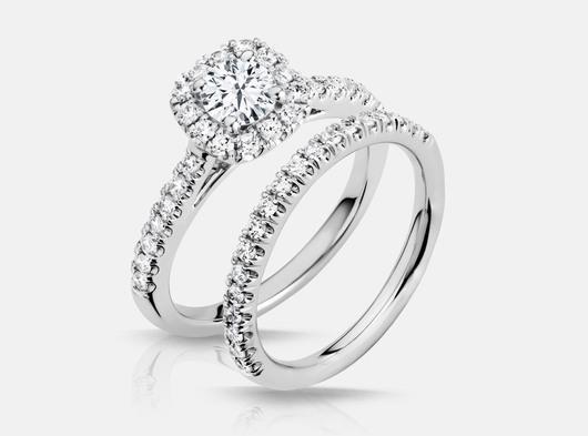 White_gold_halo_prong_set_diamond_engagement_ring