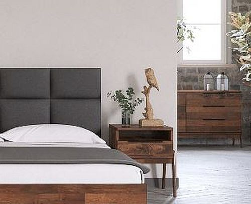 Modern dark grey upholstered headboard surrounded by reclaimed wood bedroom furniture and neutral walls and floor