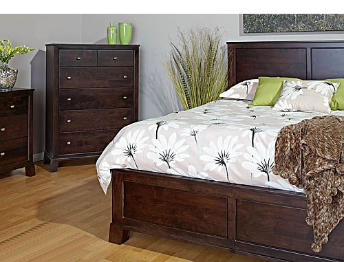 Dark brown traditional wood bed frame and headboard with matching dressers