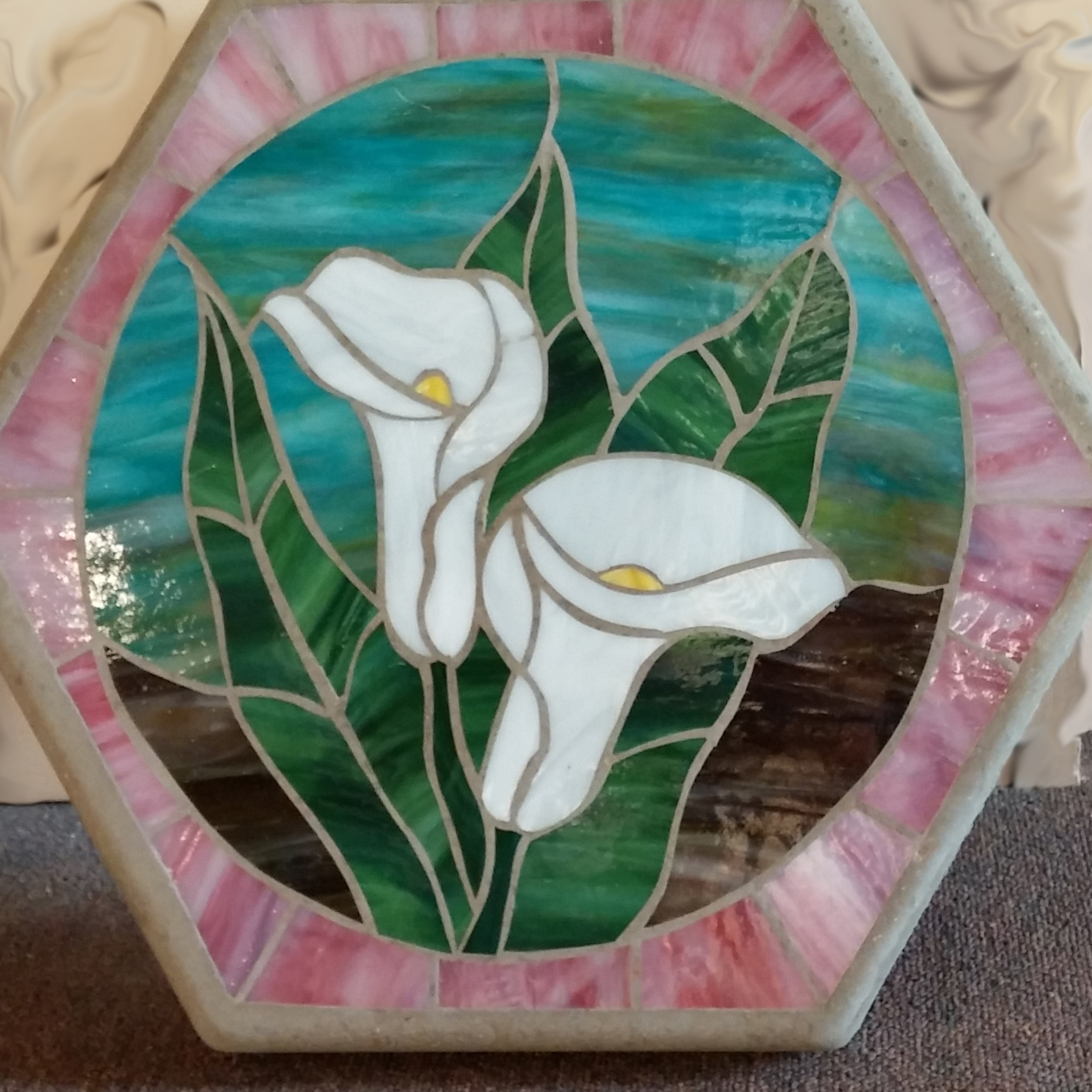 Mosaic stepping stone class project example.