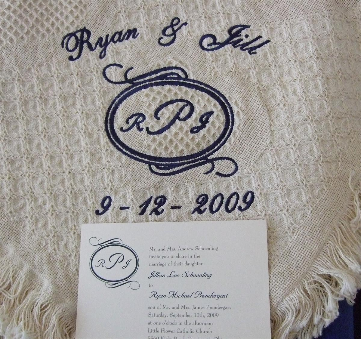 Monogram from wedding invitaion on blanket