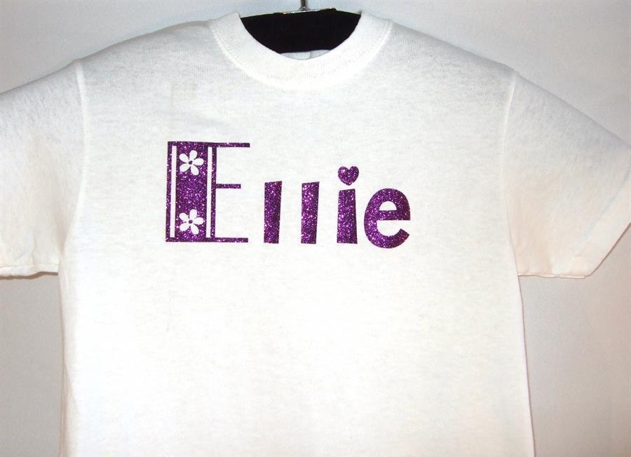 White custom youth tee with glitter name