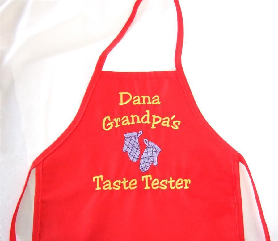 Child's red apron with custom saying.