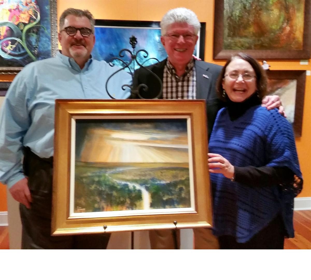 Jos Biviano with clients who purchased The Lark Ascending painting that travels now to a juried Museum show.